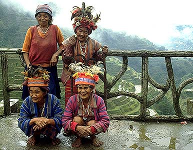 Ifugao people. Here, at a scenic overlook of the rice terraces, four